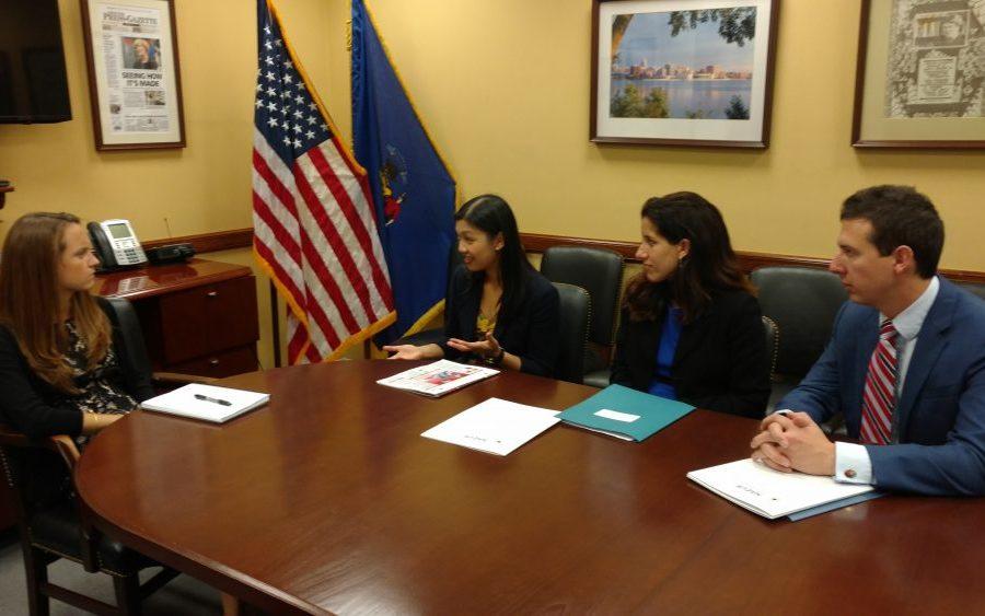 Yao Liu and Wisconsin representatives presenting project to Congressional representative