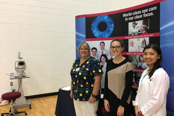 Dr. Liu and team at health fair booth