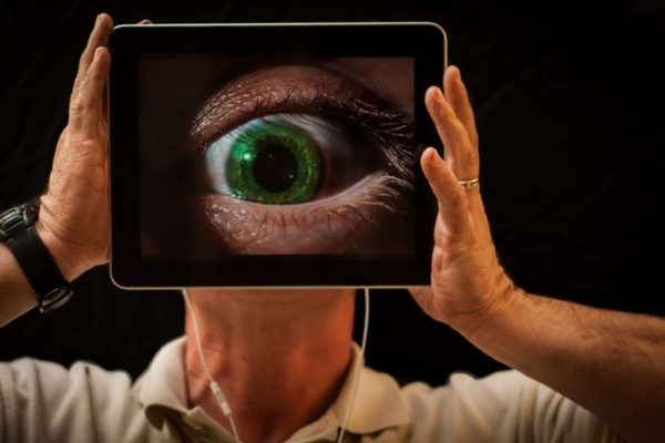 eye being magnified by an iPad